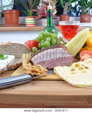 Meal Concept With Bread, Onion, Tomatoes, Cheese, Wine, Bacon And Pepper.