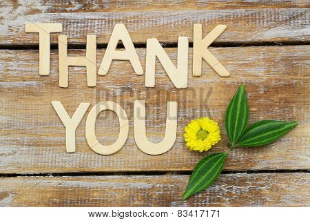 Thank you written with wooden letters and Santini flower on rustic wood poster