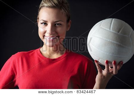 young, beauty volleyball player. Isolated on black in studio