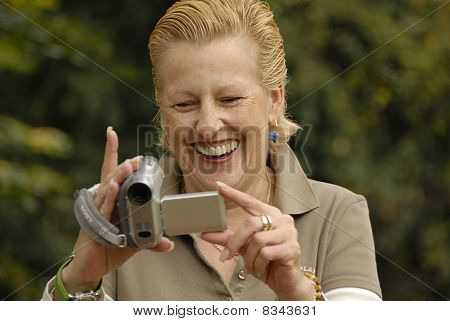 Middle aged woman filming