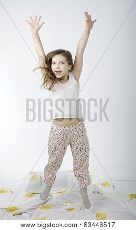 Little Girl Jumping On Bed Isolated