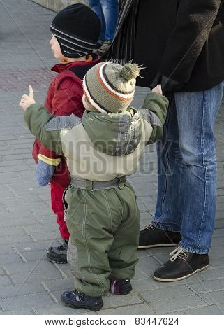 Father And Children On Street