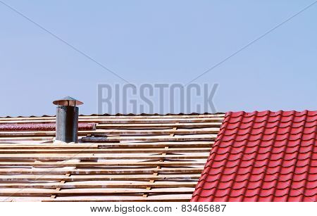 New metallic tiled roof with smokestack under constrution poster