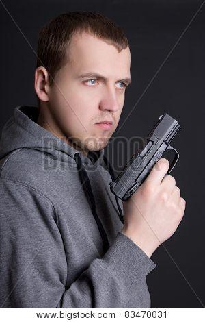 Young Man Criminal With Gun Over Grey