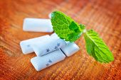 mint gum on the wooden table, sweet gum poster