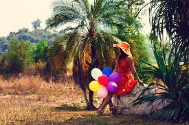 The woman with balloons. Vintage filter