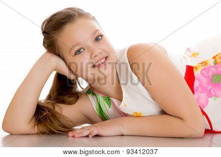 Cheerful girl lying on the floor