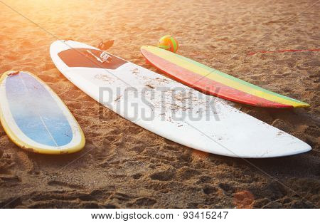 Colorful surfboard on the sand summer time with best friends