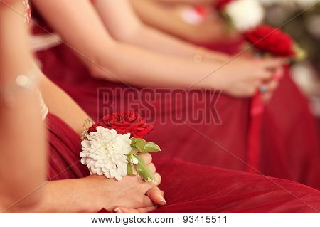 Hands Of A Bridesmaid Holding A Flower