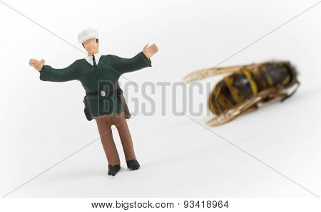 Miniature Police Officer Guarding A Crime Scene - Dead Wasp
