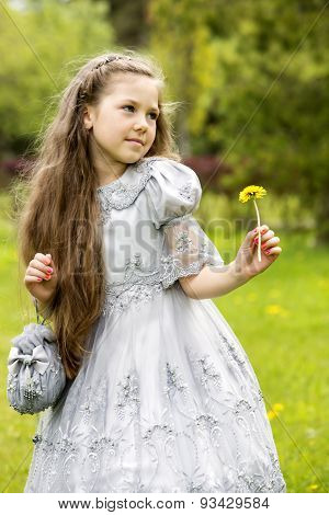 Girl With A Dandelion In Her Hand