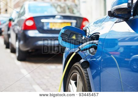 Altrernative eco energy fuel. Close up of the power supply plugged into an electric car during charging in Amsterdam
