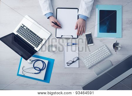 Doctor Writing Medical Records
