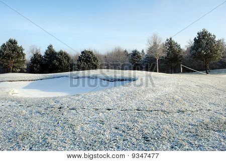 snow on a golf course
