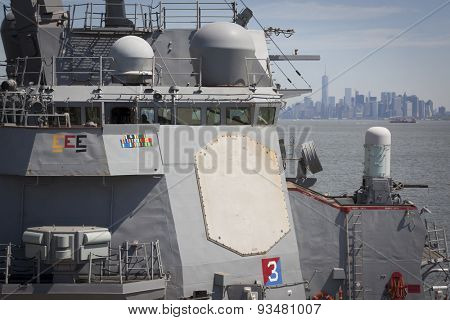 STATEN ISLAND, NY - MAY 24 2015: Radar panel and bridge of the guided-missile destroyer USS Stout (DDG 55) moored at Sullivans Pier during Fleet Week NY 2015, with Manhattan skyline in the background.