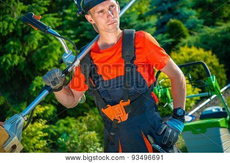 Satisfied Professional Gardener with Shoulder Lawn Mower. Landscaping Business. poster