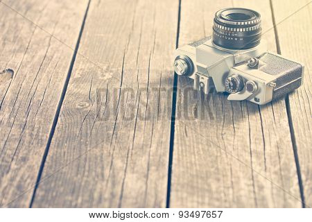 vintage photo shot of camera on old wooden table