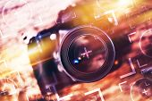 Photography Camera Lens Glass Closeup. Modern Camera on the Old Wooden Table with Concept Photo Elements. Photography Concept. poster