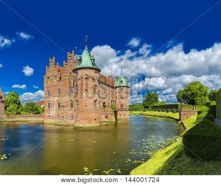 Kvaerndrup, Denmark - August 11, 2016: Egeskov Castle, located in the south of the island of Funen, Denmark.