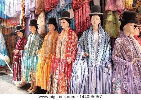 Traditional Bolivian holiday costume for Cholita women in La Paz, Bolivia, South America