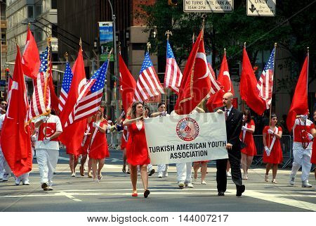 New York City - May 22, 2009: Marchers carrying Turkish and American flags at the Turkish Day Parade on Madison Avenue
