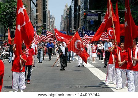 New York City - May 22 2009: Marchers carrying Turkish and American flags at the annual Turkish Day Parade on Madison Avenue