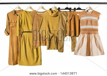 Group of yellow clothes clothes racks isolated over white