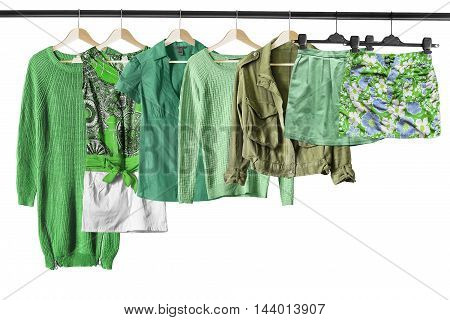 Set of green clothes on clothes racks isolated over white