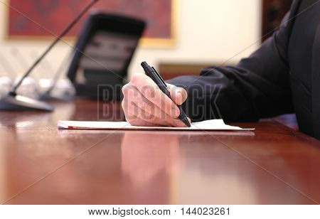 Businessman working on the contract business meeting contract signing concept .