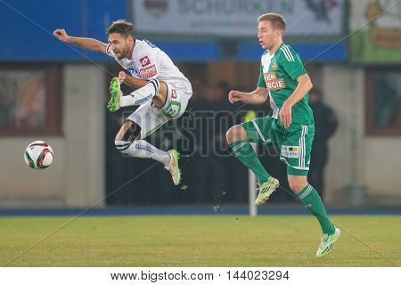 VIENNA, AUSTRIA - FEBRUARY 28, 2015: Michael Madl (#15 Sturm Graz) and  Robert Beric (#9 Rapid) fight for the ball in an Austrian football league game.