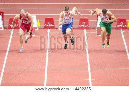 PRAGUE, CZECH REPUBLIC - MARCH 7, 2015: Jan Volko (#342 Slovakia) competes in the men's 60m event of the European Athletics Indoor Championship.