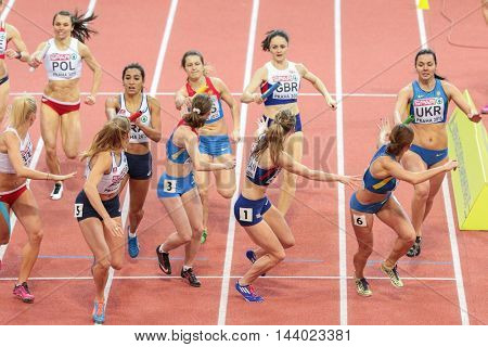 PRAGUE, CZECH REPUBLIC - MARCH 8, 2015: Marie Gayot (France) competes in the women's 4x400m relay event of the European Athletics Indoor Championship.