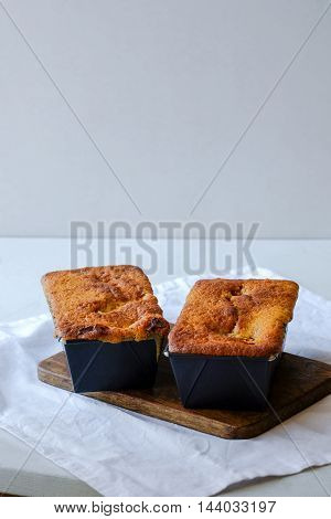 Vanilla coffee cake mini loaves in non-stick baking tins. Light food photography.