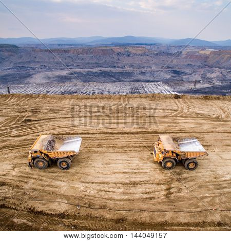 Big yellow mining trucks at a quarry