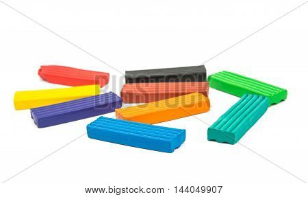 colorful modeling clay on a white background