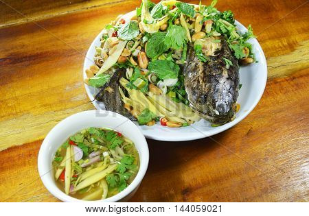 deep fried snake head fish with mixed herb and sweet sauce