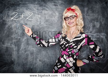Retro Teacher In Glasses Showing On Equation By Finger