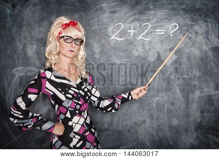Serious Retro Teacher In Glasses With Pointer