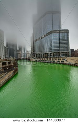 CHICAGO - MARCH 13: Dyeing the Chicago River on St. Patrick's day on Mar 13 2016 in Chicago IL