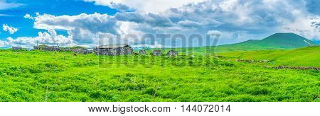The ramshackle stone buildings of the old farm on the way to Selim Pass Gegharkunik Province Armenia.