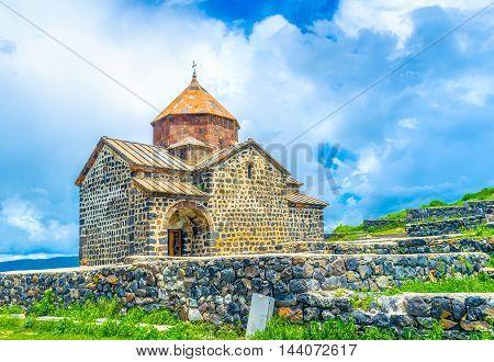 The St Astvatsatsin Church of Sevanavank Monastery neighbors with the medieval cemetery on Sevan Peninsula Armenia.