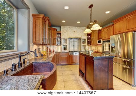 Great Kitchen Interior With Large Steel Fridge And Kitchen Island