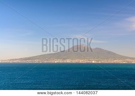 Panoramic view with sea and mount Vesuvius. Napoli (Naples) and mount Vesuvius in the background in summer day Italy.