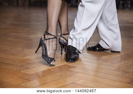 Low Section Of Tango Dancers Performing Parallel Walk