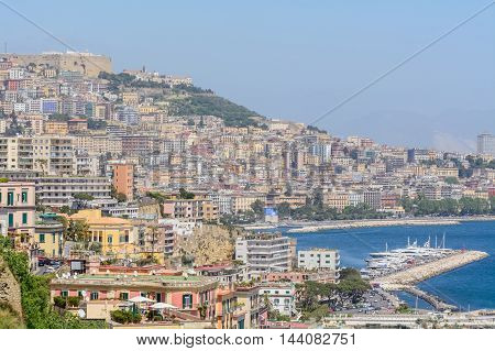 Naples (Napoli) Italy - June 10: Panorama of Naples June 10 2016 in Naples Italy. View of the port in the Gulf of Naples houses and sea.