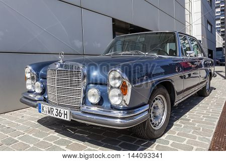 COLOGNE GERMANY - AUG 7 2016: Historic Mercedes Benz W108 luxury sedan from ca. 1970 at an exhibition in the city of Cologne Germany