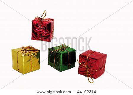 Red, Green and Gold cube shaped gift packages