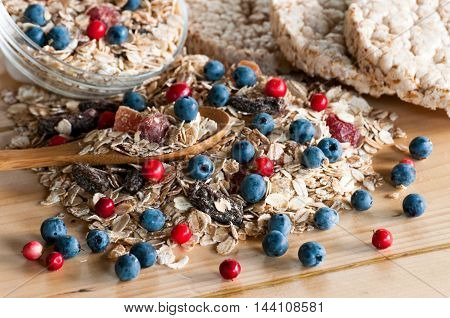Serving Of Wild Berries Cereal, Crispbread Bulk On Wooden Table