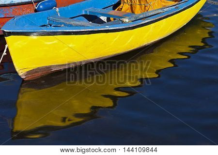 yellow boat with in the sea with reflection