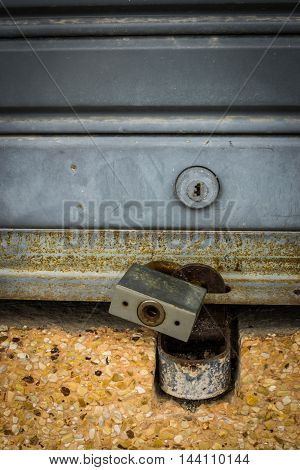 Old lock on the door. lock on the door of an old warehouse. close-up. focus on lock